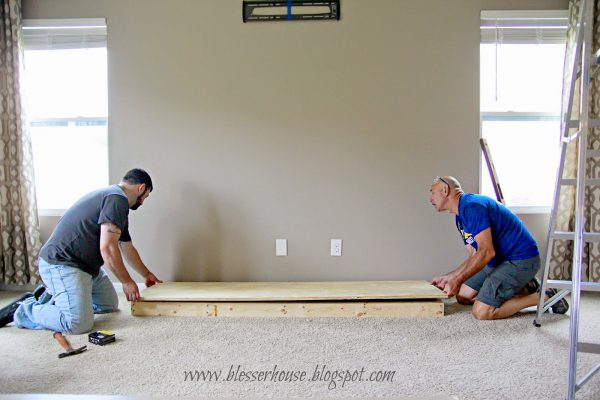 building the hearth base for diy faux fireplace - Blesser House featured on @Remodelaholic