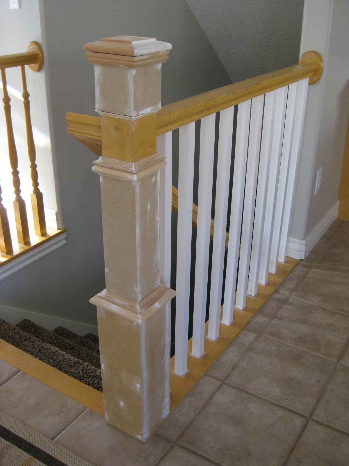 Remodelaholic stair banister renovation using existing for Diy kitchen remodel steps