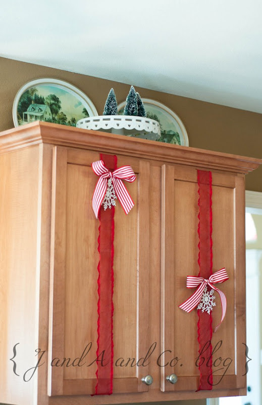 Easy Christmas Decor For Kitchen Cabinets   J And A And Co Via  @Remodelaholic