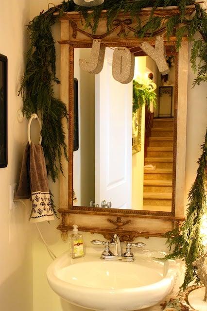 evergreen boughs and garland for Christmas bathroom decor - My Sweet Savannah via @Remodelaholic