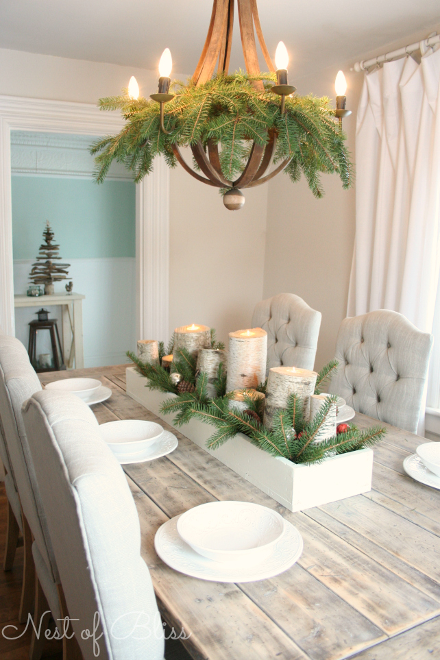 evergreen boughs in the dining room chandelier nest of bliss via