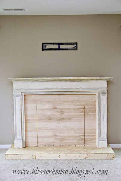 faux fireplace DIY in progress - Blesser House featured on @Remodelaholic