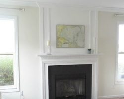 feature fireplace with faux chimneypiece woodwork trim above mantel - Provident Home Design featured on @Remodelaholic