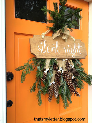 fresh evergreen door swag and sign - That's My Letter via @Remodelaholic