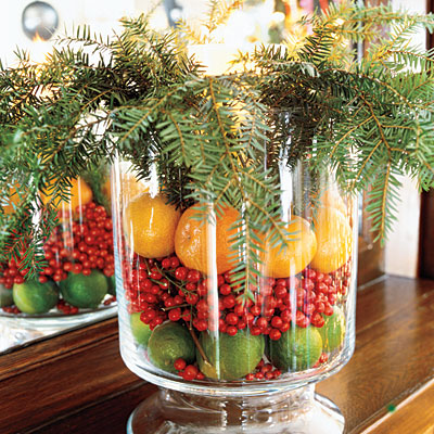 fresh fruit and evergreen branches in a glass hurricane - Southern Living via @Remodelaholic