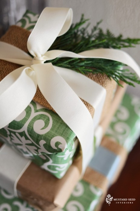 fresh greenery on presents - Miss Mustard Seed via @Remodelaholic