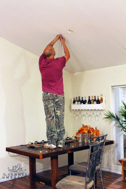 how to install a hanging mason jar chandelier pendant - The Summery Umbrella featured on @Remodelaholic