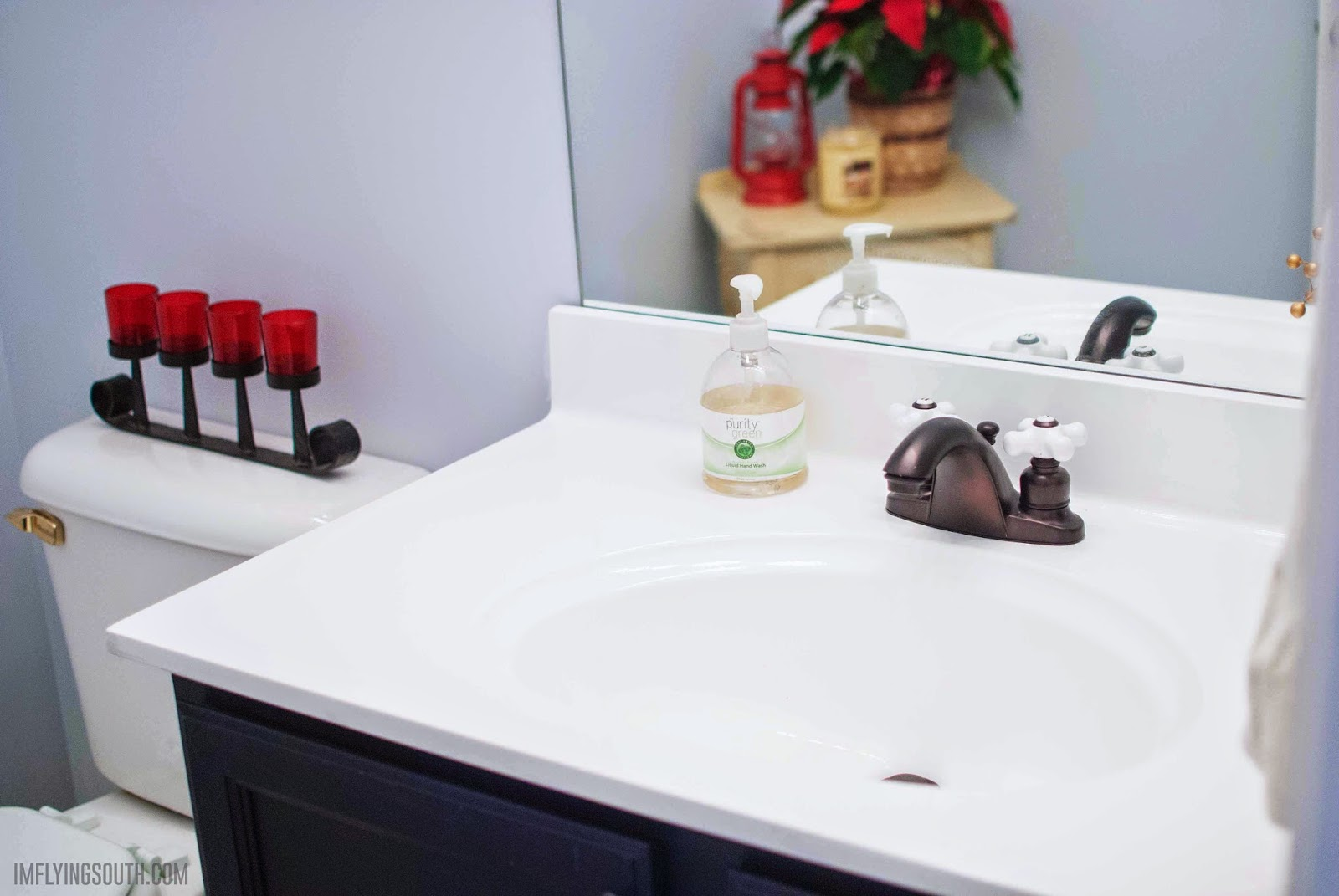 inexpensive painted bathroom sink makeover - I'm Flying South featured on @Remodelaholic