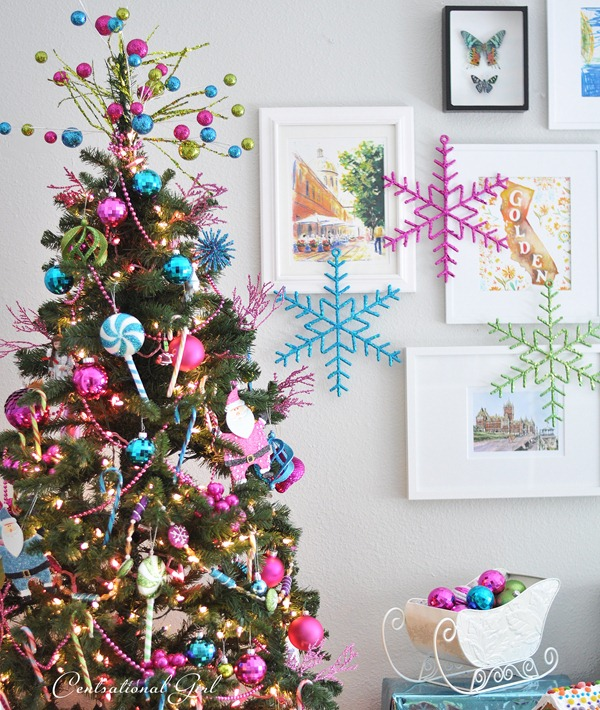 large snowflake ornaments on gallery wall centsational girl via remodelaholic - Candyland Christmas Door Decorations