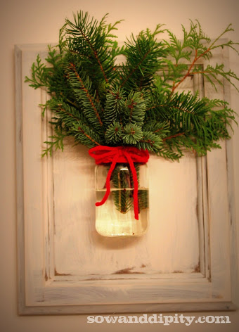 mason jar wall vase with fresh pine and evergreen boughs - Sowanddipity via @Remodelaholic