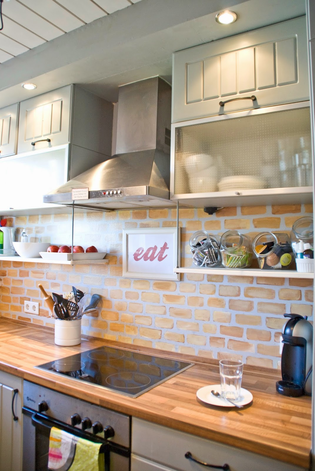 Painted faux brick backsplash with wood countertops pudel design featured on remodelaholic