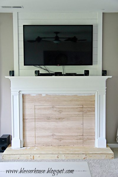 painting the faux fireplace - Blesser House featured on @Remodelaholic
