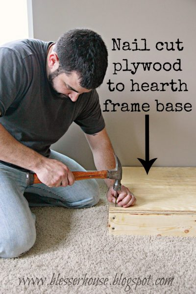 plywood hearth base for faux fireplace - Blesser House featured on @Remodelaholic