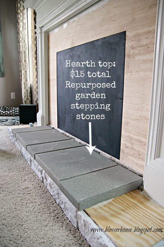 repurposed garden stepping stones for faux fireplace hearth - Blesser House featured on @Remodelaholic