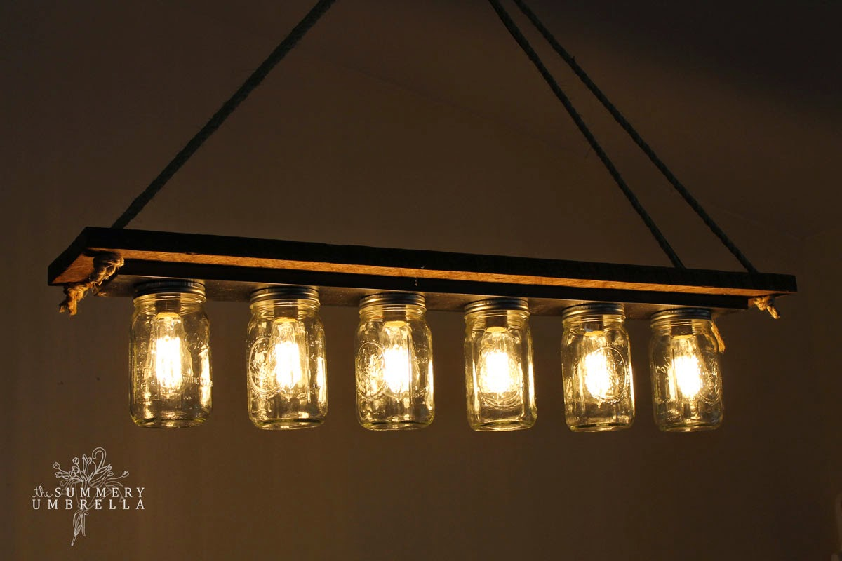 Elegant rustic wood mason jar chandelier tutorial The Summery Umbrella featured on Remodelaholic