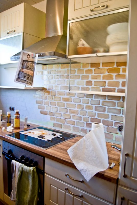 small kitchen with painted faux brick backsplash pudel design