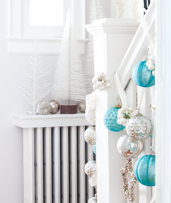tiffany blue christmas ornament baubles on stairs - Style at Home via @Remodelaholic