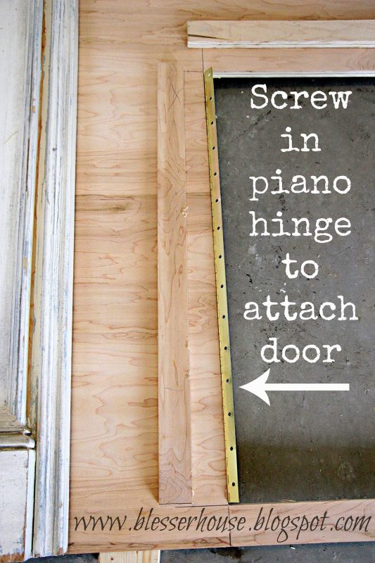 use a piano hinge to attach a door on the faux fireplace - Blesser House featured on @Remodelaholic