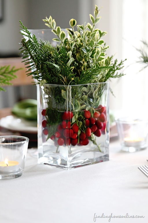 use fresh evergreen as a table centerpiece - Finding Home Online via @Remodelaholic