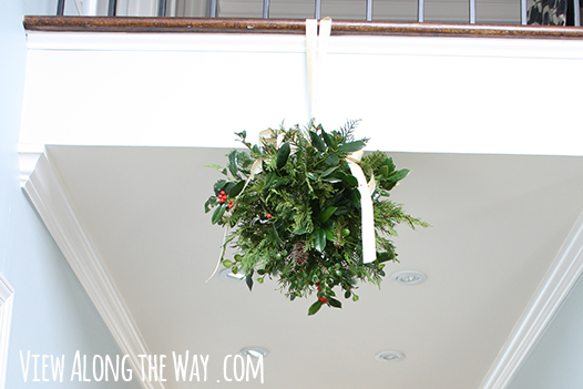 use fresh greenery to make a DIY kissing ball for Christmas - View Along the Way via @Remodelaholic