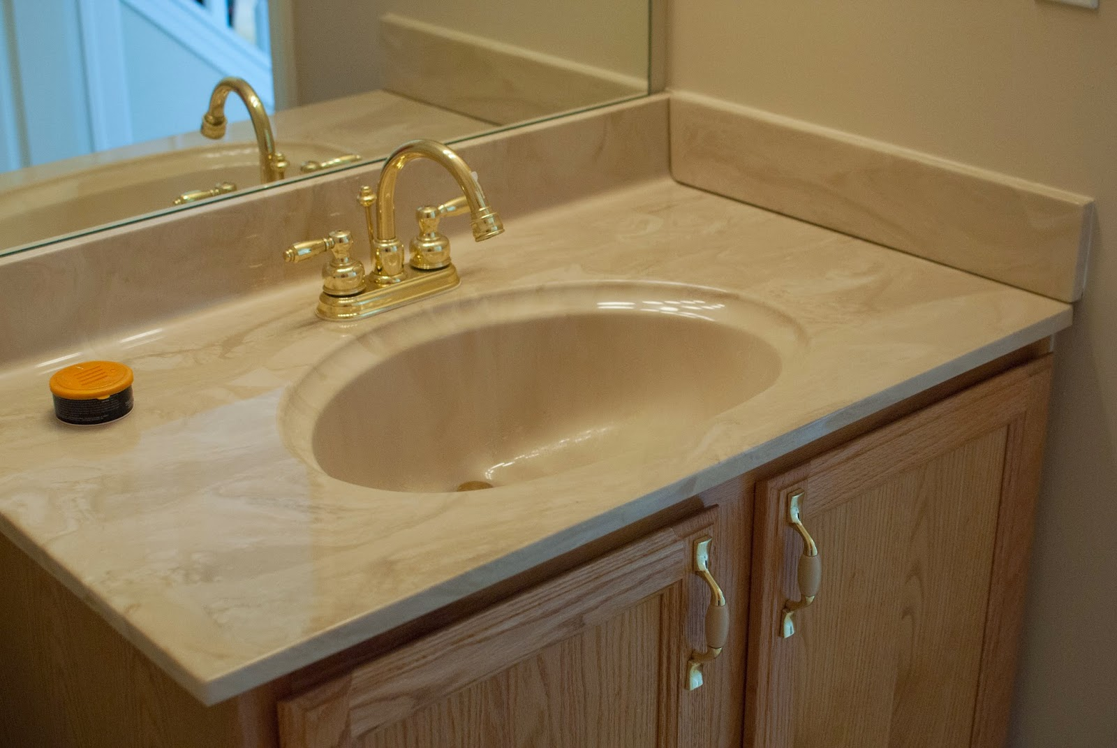 Marble bathroom counter tops - Vanity Sink And Countertop Before I M Flying South Featured On Remodelaholic
