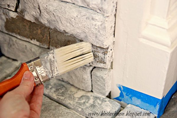 whitewashing airstone fireplace - Blesser House featured on @Remodelaholic