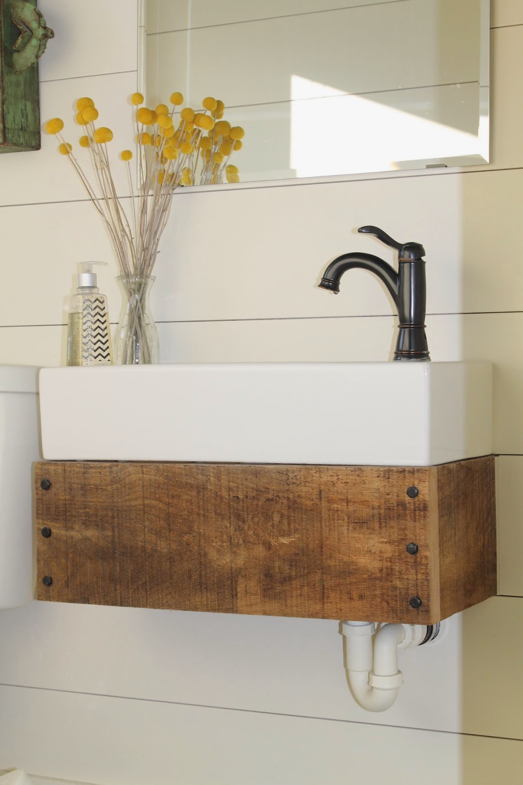 Nice DIY floating vanity from reclaimed wood Girl Meets Carpenter featured on Remodelaholic