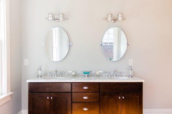(Hawthorne) spacious open bathroom with wood floor dark espresso double vanity mirrors @Remodelaholic
