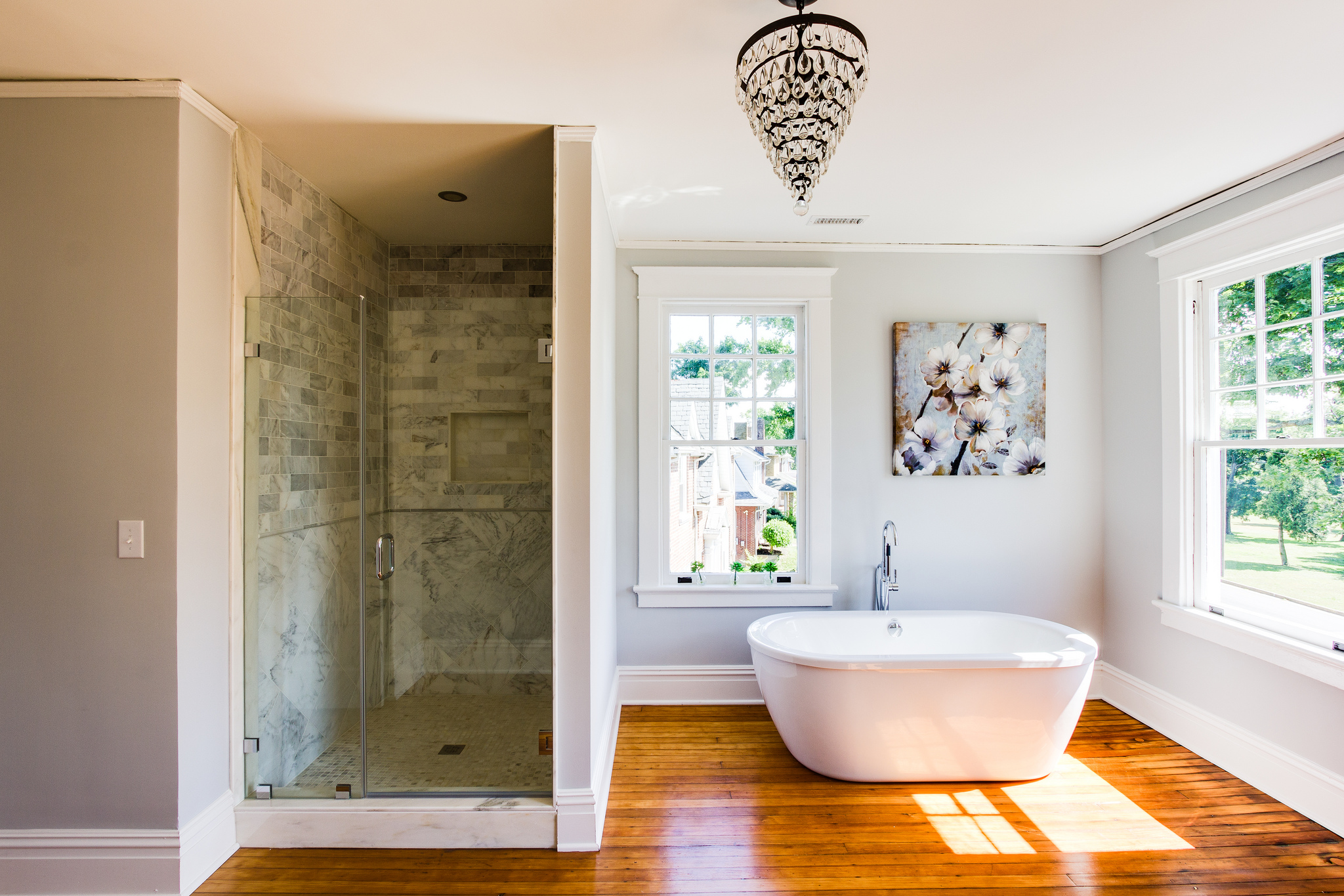 Remodelaholic   Spacious Bathroom Inspiration  Hawthorne  spacious open bathroom with wood floor  walk in marble shower   and. Bathrooms Near. Home Design Ideas