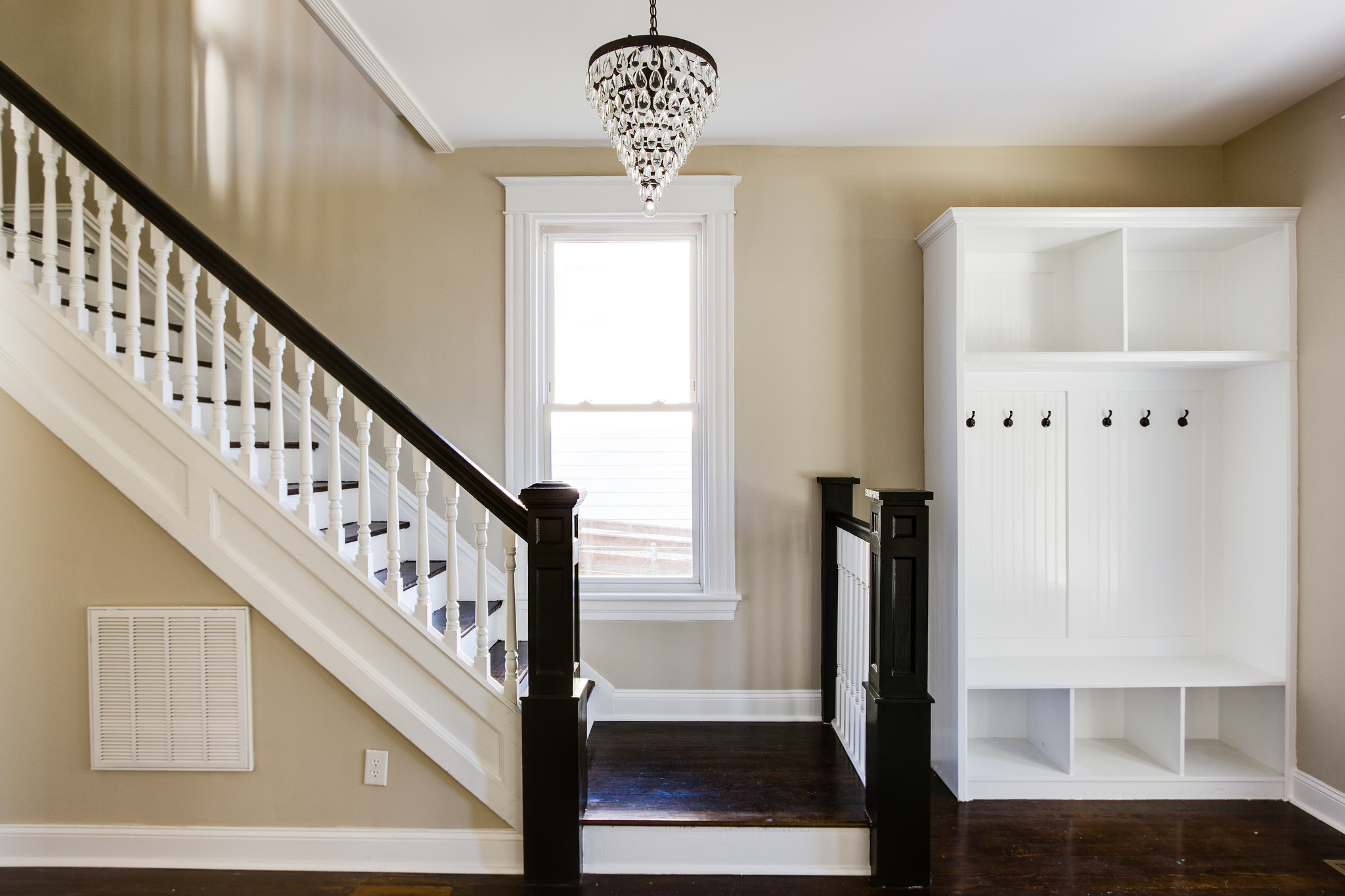 Remodelaholic renovating for an inviting entryway for Foyer staircase ideas