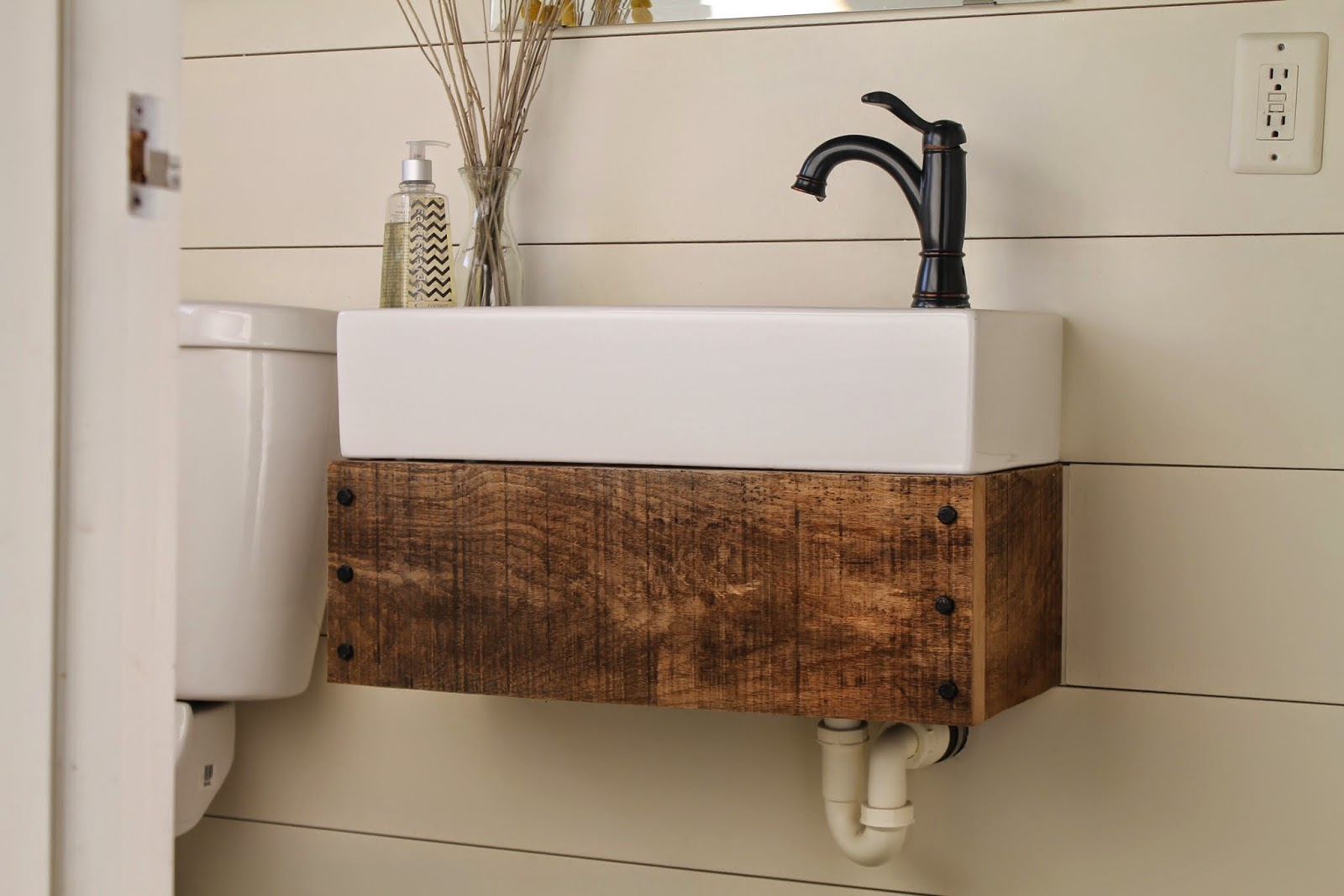 Awesome diy floating reclaimed wood vanity with IKEA sink Girl Meets Carpenter featured on Remodelaholic