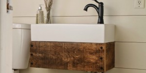 feature diy floating reclaimed wood vanity with IKEA sink - Girl Meets Carpenter featured on @Remodelaholic
