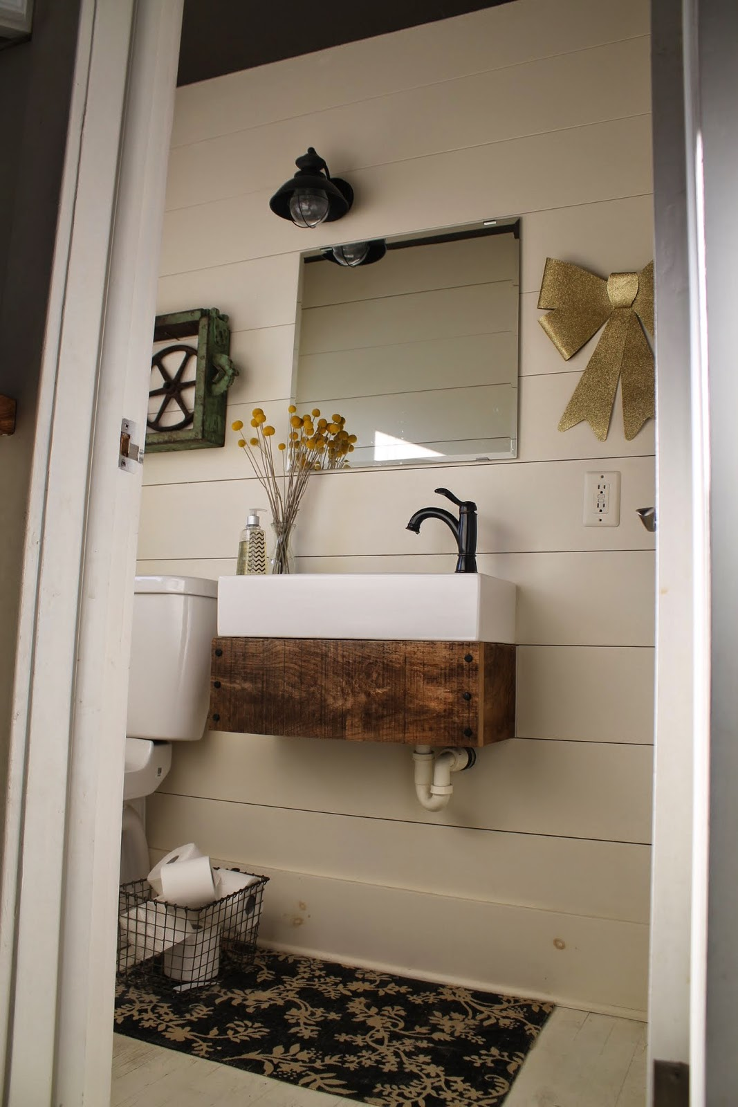 Trend industrial style bathroom with planked walls and DIY floating reclaimed wood vanity Girl Meets Carpenter