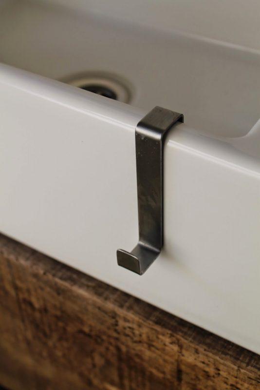 towel holder on the side of bathroom sink floating vanity - Girl Meets Carpenter featured on @Remodelaholic
