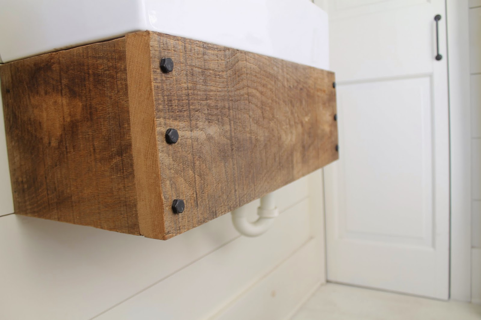 Best use reclaimed wood to make an easy floating bathroom vanity Girl Meets Carpenter featured on
