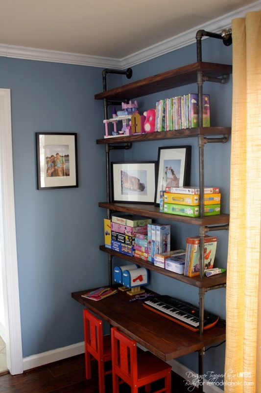 Remodelaholic diy industrial pipe shelves and desk for Diy industrial bookshelf
