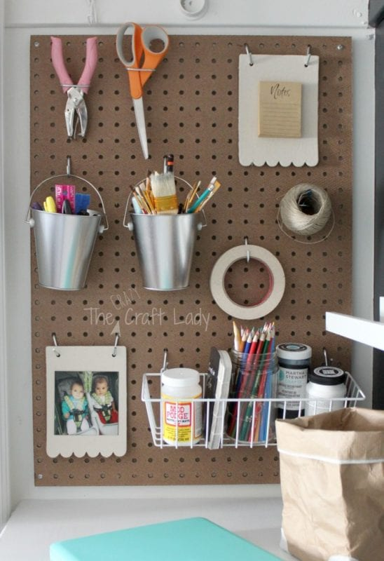 Organize craft supplies in a closet home office - The Crazy Craft Lady featured on @Remodelaholic