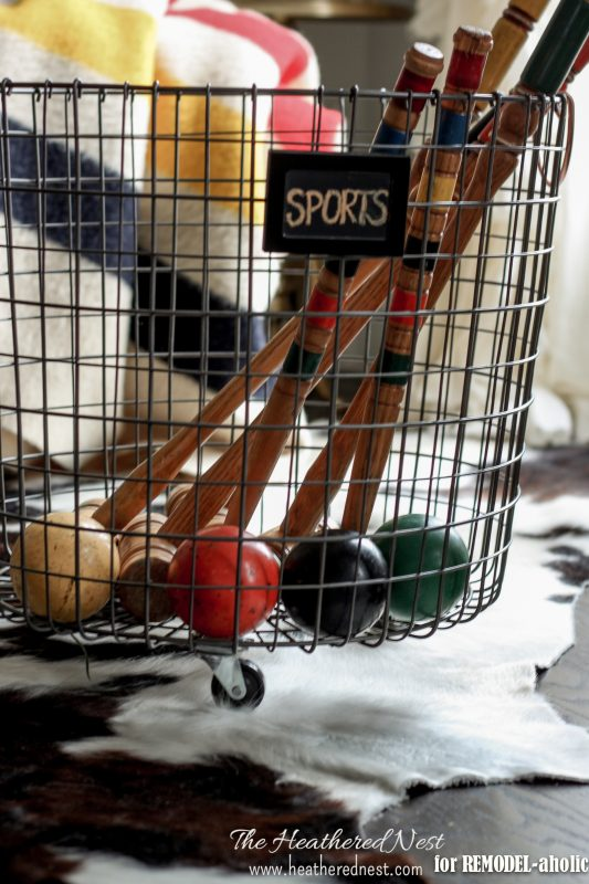 diy wire baskets with casters and chalkboard labels - The Heathered Nest on @Remodelaholic