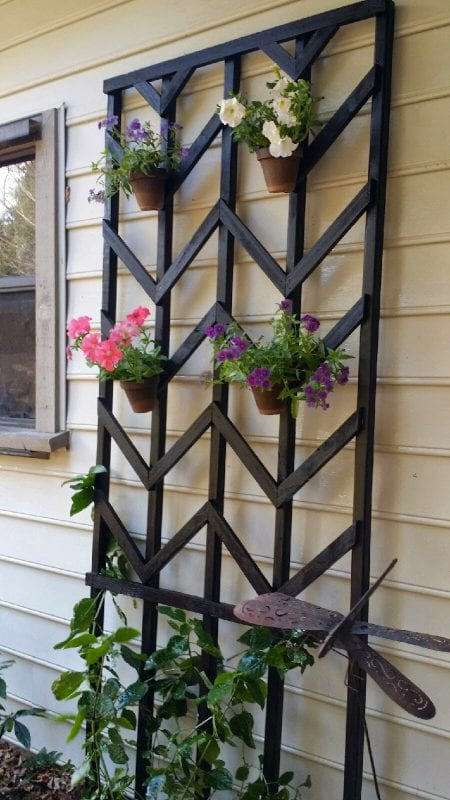 hang flower pots on a painted chevron diy lattice - Easter Avenue Co on @Remodelaholic
