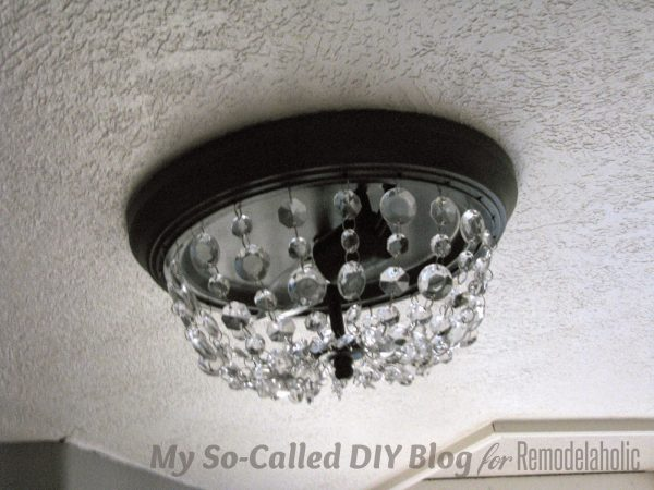 make a Pottery Barn knockoff Mia crystal strand flushmount light - My So-Called DIY Blog on @Remodelaholic
