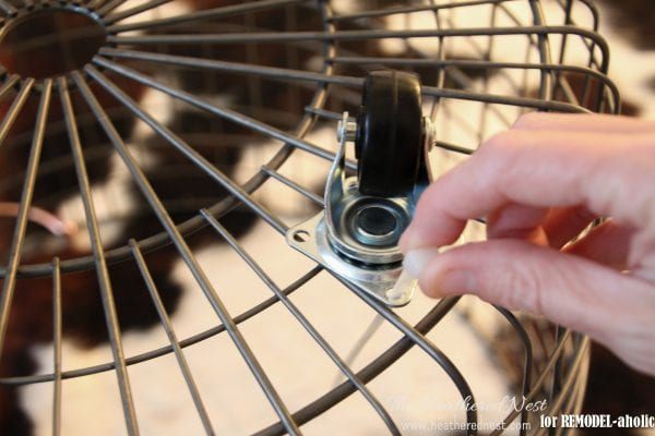 use casters to make your own rolling wire baskets - The Heathered Nest on @Remodelaholic