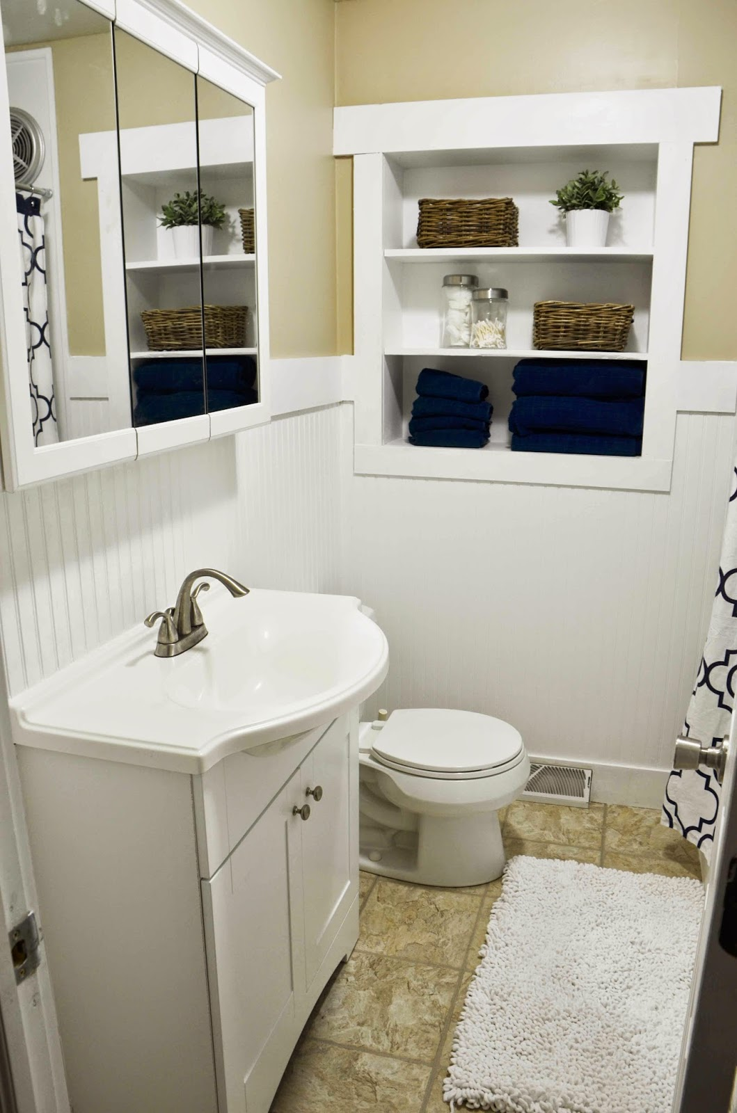Inspirational white bathroom remodel with in wall shelving Since I Became A Mom