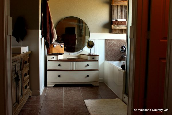 Bathroom makeover with added storage by The Weekend Country Girl featured on @Remodelaholic
