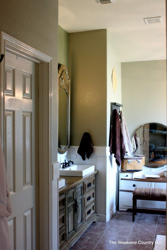 Board and Batten Bathroom Makeover with Chandelier by The Weekend Country Girl featured on @Remodelaholic