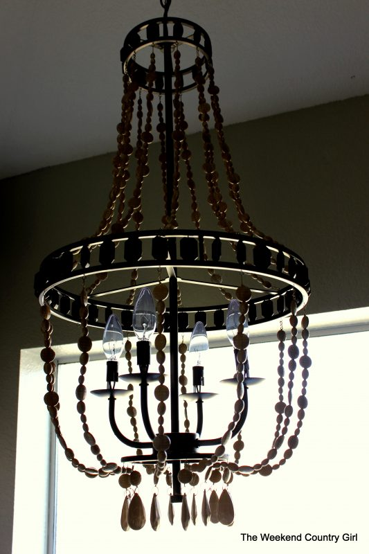 Chandelier Makeover for an Updated Bathroom by The Weekend Country Girl featured on @Remodelaholic