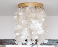 Ban your boob light! Change it to a drum shade or capiz fixture in as little as five minutes, no tools required!