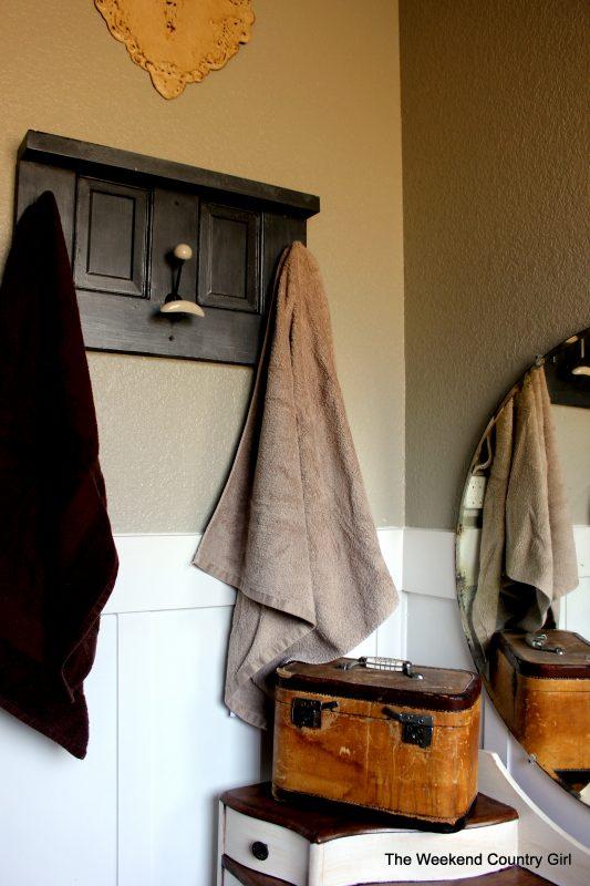 Door repurposed into towel rack by The Weekend Country Girl featured on @Remodelaholic