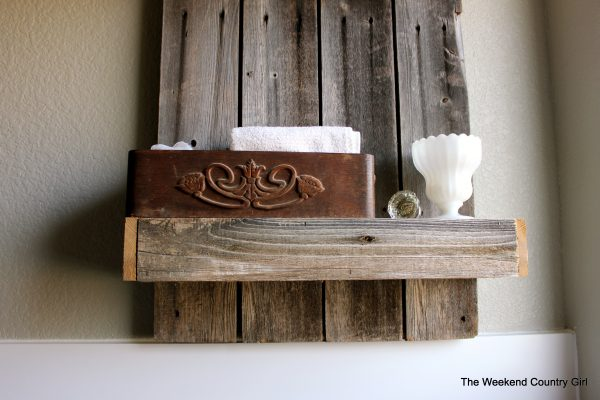 Rustic bathroom shelf by The Weekend Country Girl featured on @Remodelaholic
