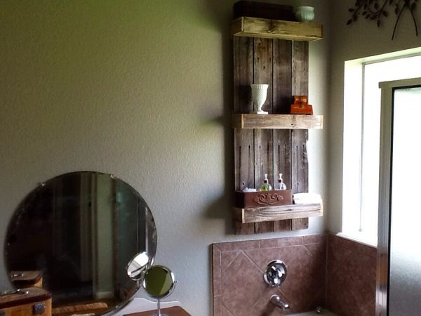 Rustic bathroom shelf created from weathered wood by The Weekend Country Girl featured on @Remodelaholic