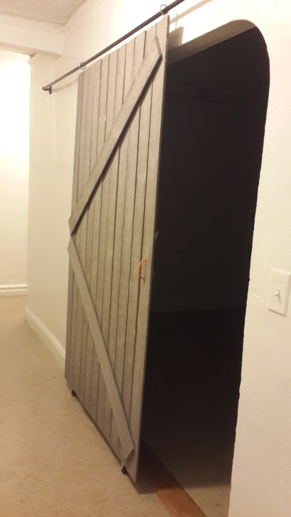 Remodelaholic diy sliding barn door inexpensive hardware for Door gap filler